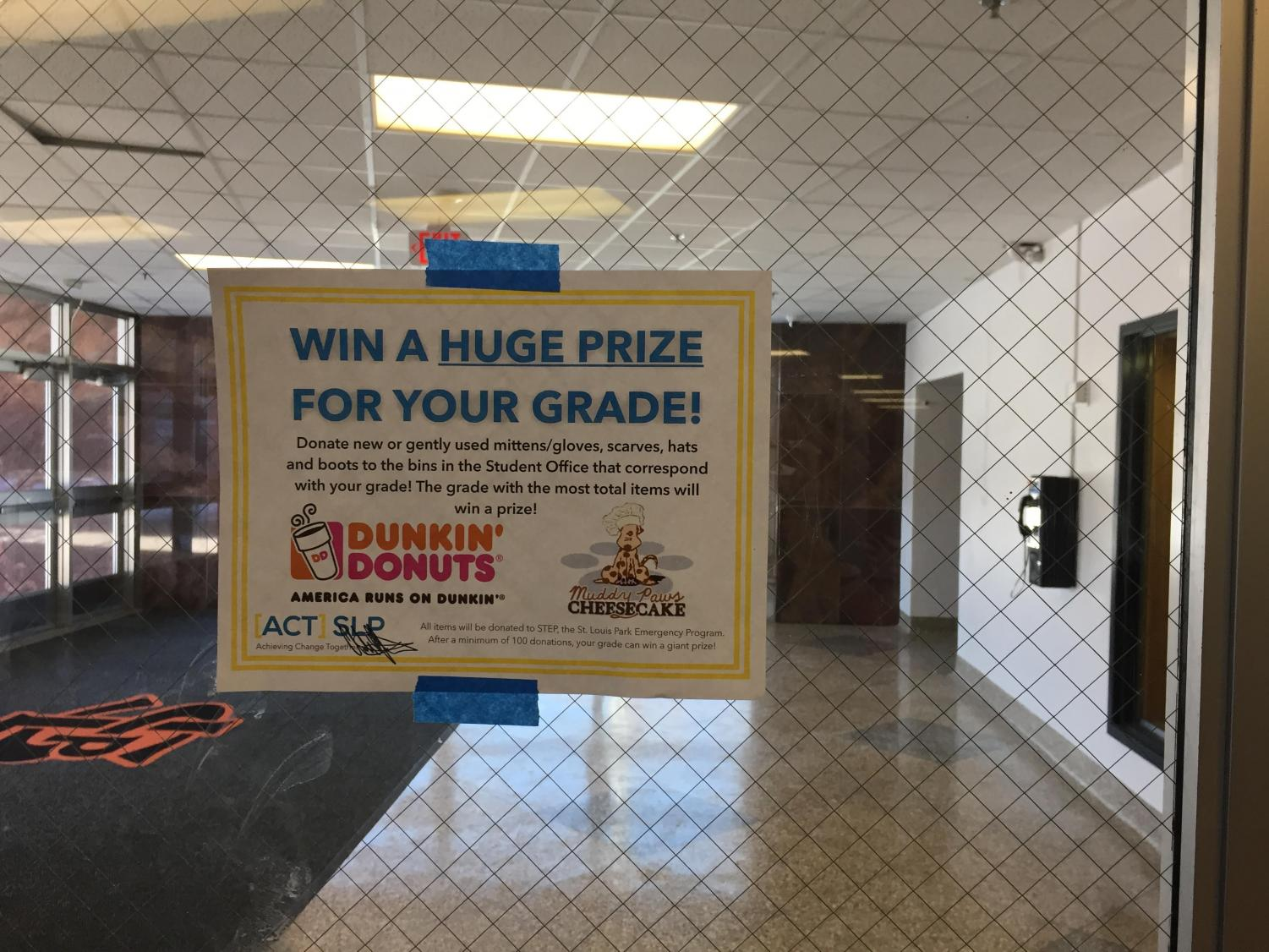 Posters hung around the school advertise the ACT winter coat drive. In an announcement on Feb. 12, the freshman class was revealed to be the winners of the drive competition.