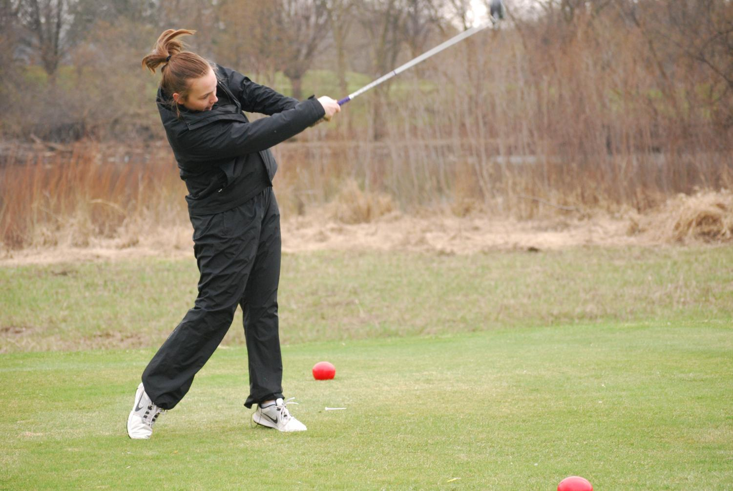 Senior Carly Livingston hits the golf ball at a golf match at Theodore Worth Park. The 2018 season will begin at the end of March.