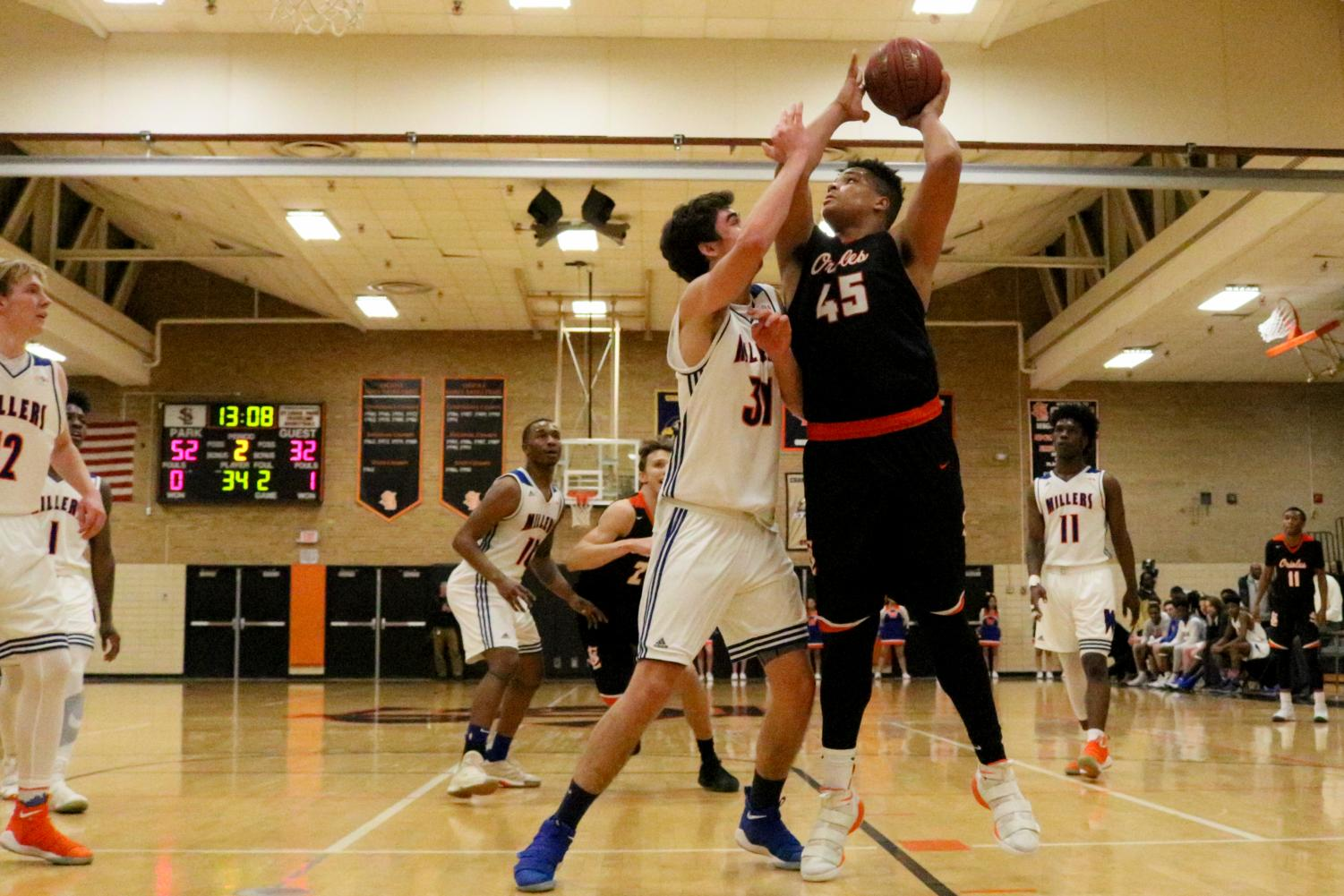 Junior Anthony Rayson posts up against Washburn's Gavin Yares during the second half of Park's first section game Mar. 6. Park defeated Washburn 85-70 and will play at 7:00 p.m. March 9 at Osseo High School against Wayzata for a spot in the section finals.