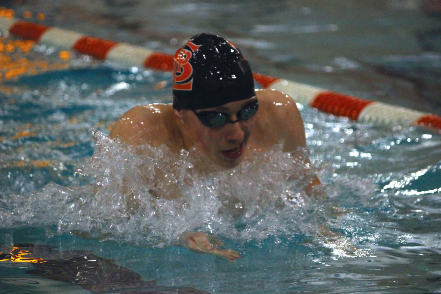Junior Luke Anderson swims the breaststroke during practice in preparation for State competition March 3.   Anderson attended this year's State competition for the first time, swimming the 100 backstroke.