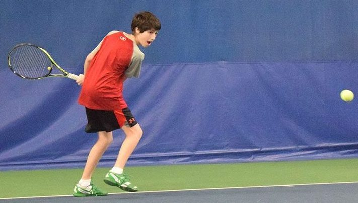 Sophomore Rafe Covin coils to swing a backhand at captains' practice during the 2017 season. According to head coach David Breitenbucher, tryouts will be 3:30-5:00 p.m. April 2-4 at the St. Louis Park High School tennis courts.