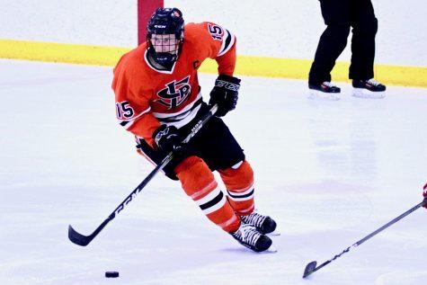 Senior travels to Alaska to play hockey