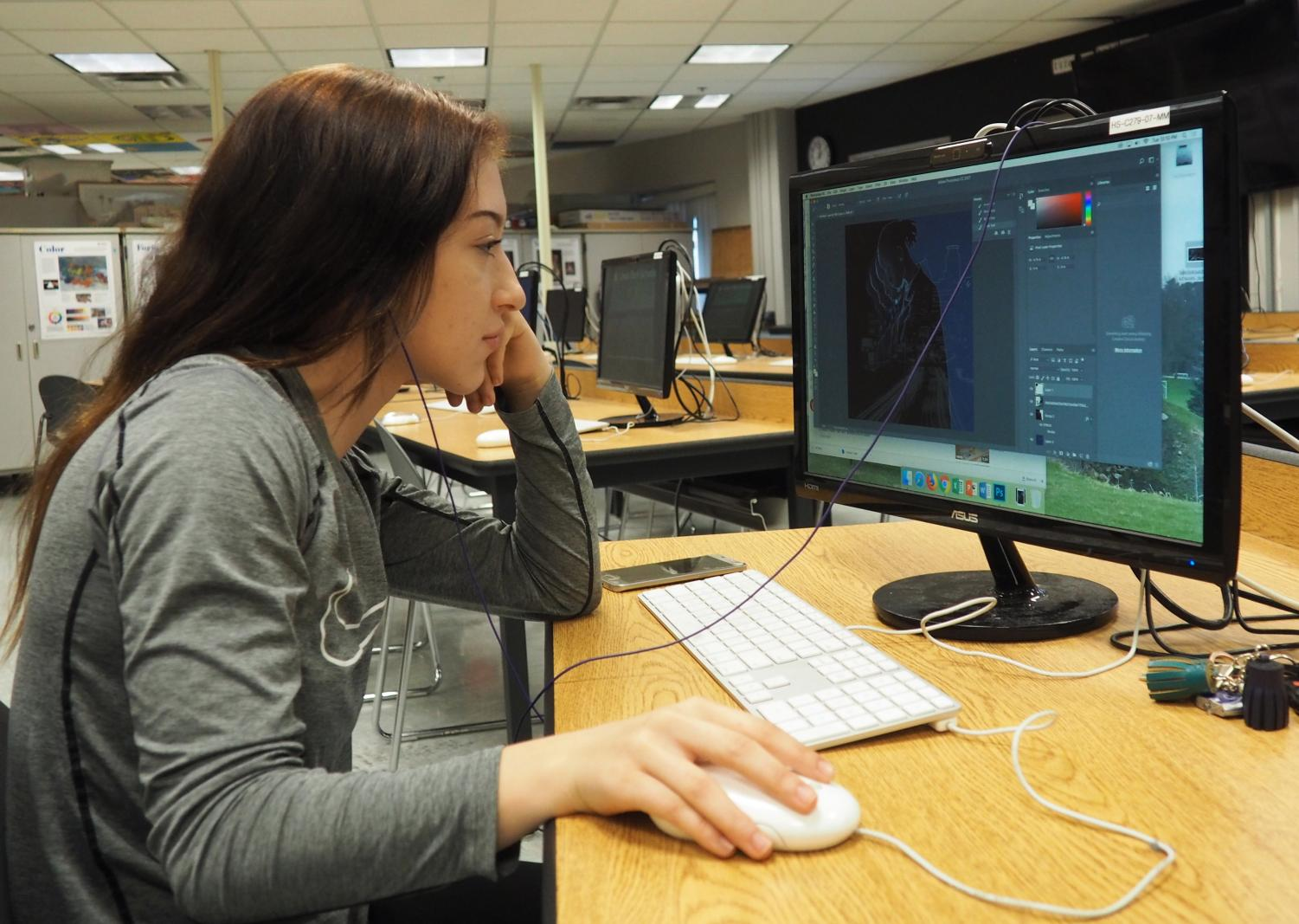 Senior Alex Monson works on her graphics. Monson is currently seeking career opportunities in graphic design.