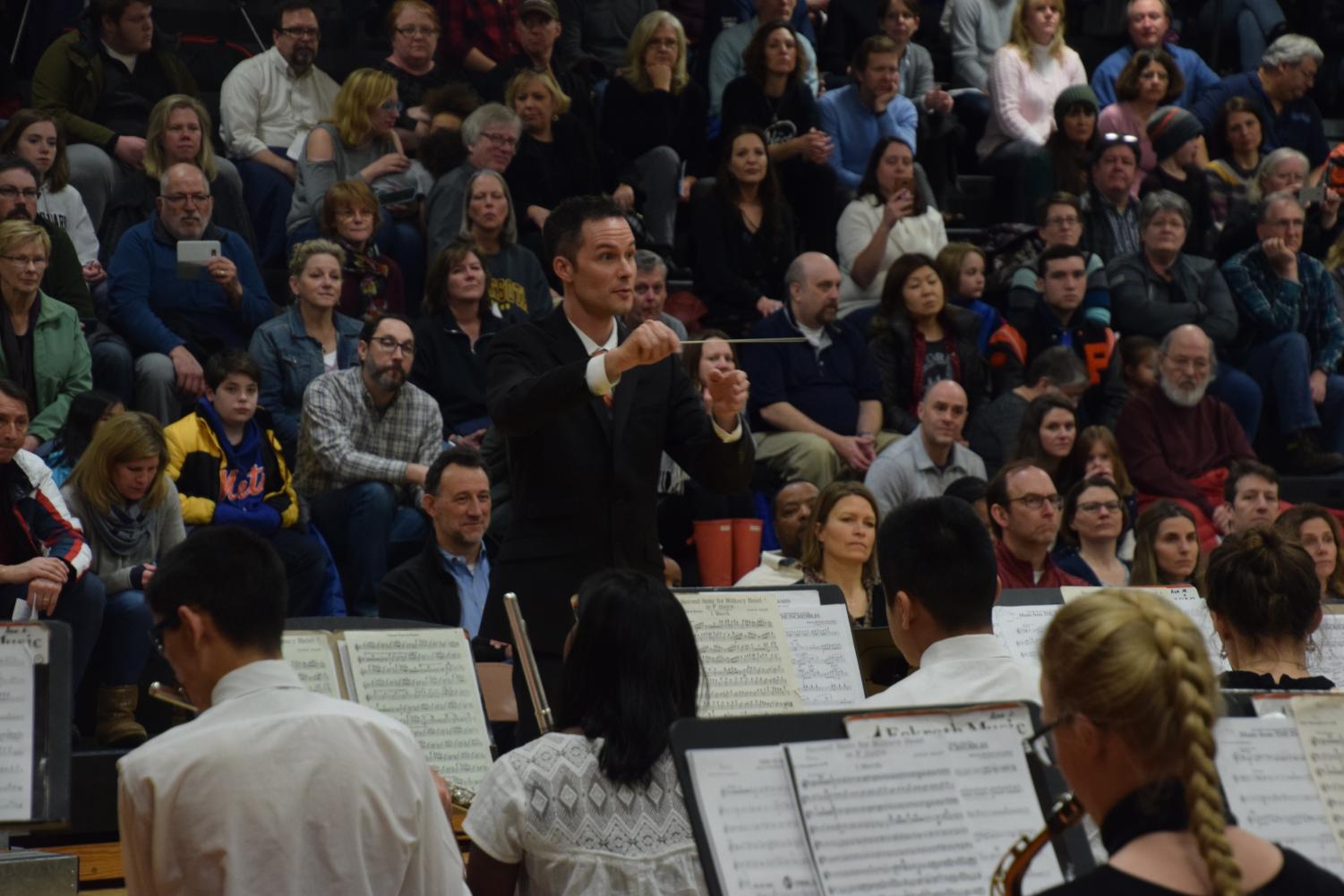Band director Steven Schmitz conducts the high school band during the district wide concert Feb. 26. Schmitz will be teaching band in Cape Town, South Africa from May 13 to June 6.