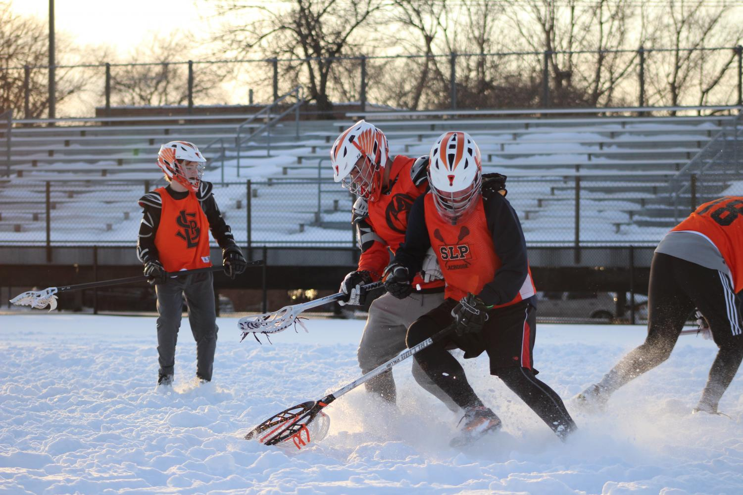 Boys' lacrosse team conducts tryouts despite snow at Park's stadium. Tryouts took place April 2-5.