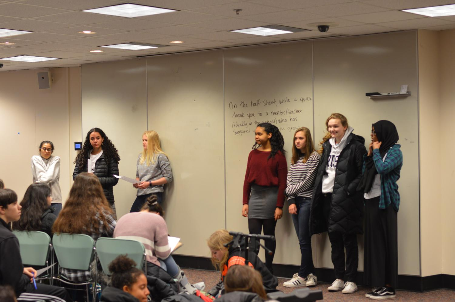 New NHS officers accept their positions during an NHS meeting April 4. The officers will be officially inducted later this month.