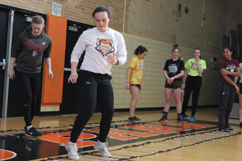 Senior varsity softball captain Annabelle Schutte runs a drill at practice March 16. Schutte pitches for Park's softball team.