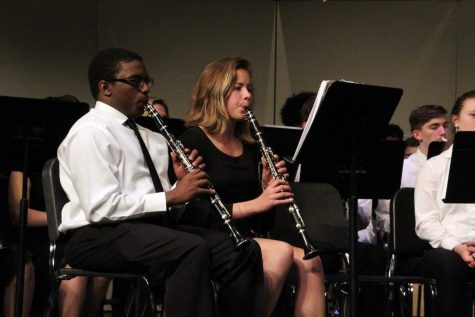 Senior Jeffrey Robinson Jr. and junior Lexi Lee play the clarinet during the Wind Ensemble's performance of