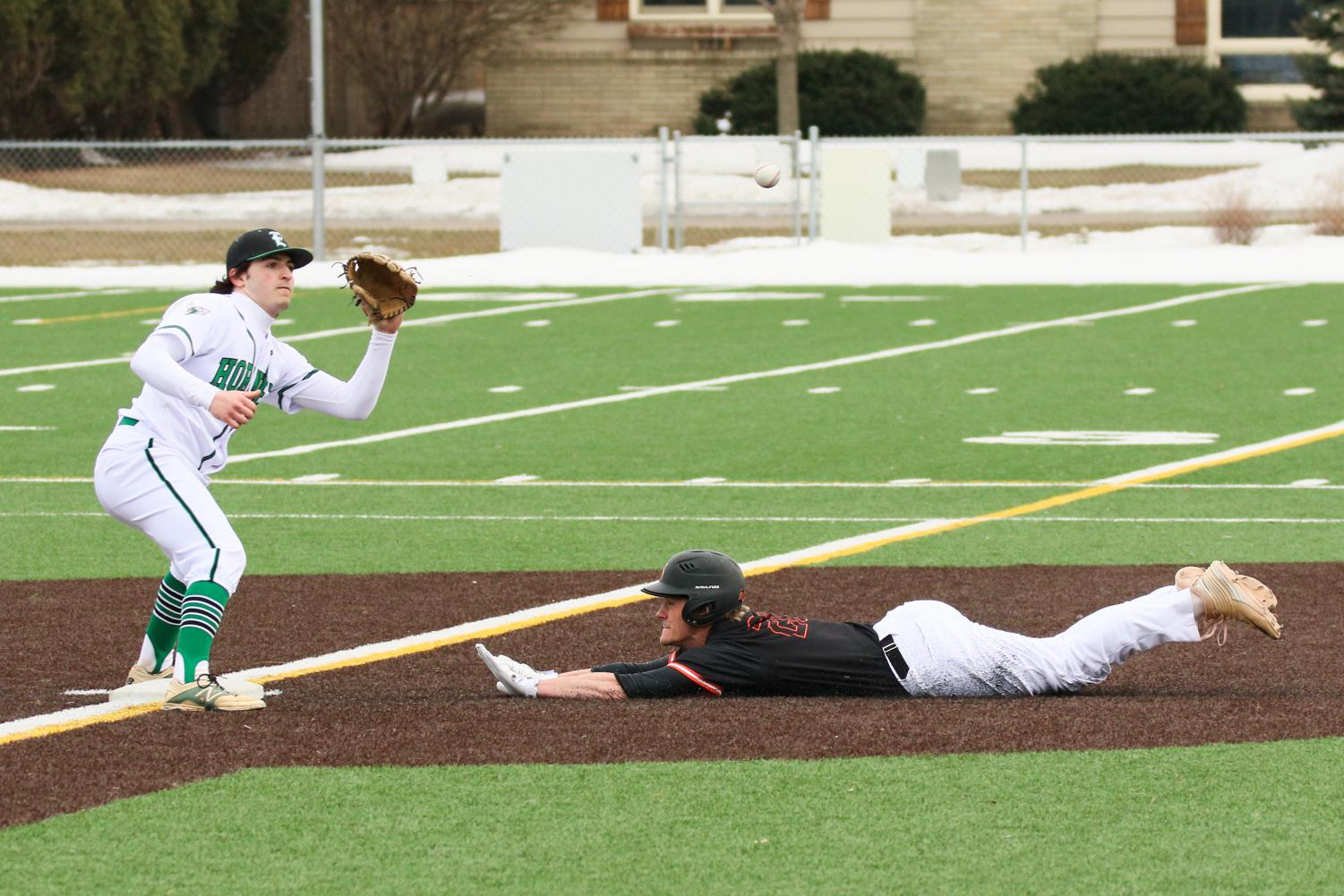 Senior captain Riley Dvorak slides into second base during Park's first regular season game against Edina. Park scored the first run of the game, but lost 3-1.