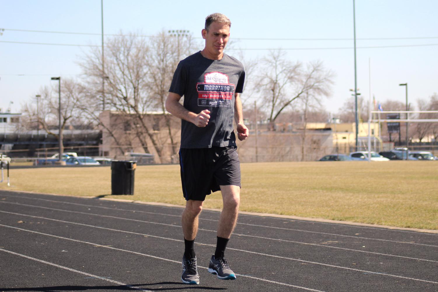 History teacher Jeffrey Cohen trains at the St. Louis Park High School track after racing the Boston Marathon April 16. He ran a time of 3:21:44.