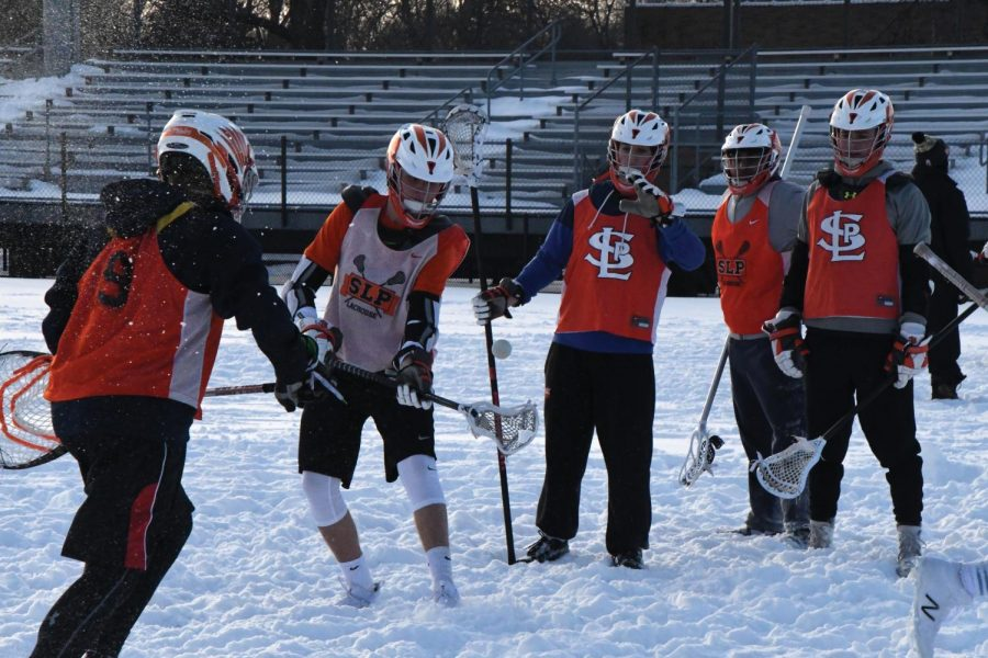 Senior captain Kyle Hedblom works on passes at lacrosse tryouts April 4. The team started practice April 2.