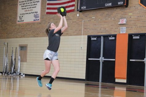 Senior Meghan Perkins participates in a drill during softball tryouts on March 16. Due to weather, varsity softball's first game, schedules for April 10, was canceled.