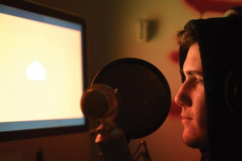 Junior Aiden Henry records in his personal studio for his next album.