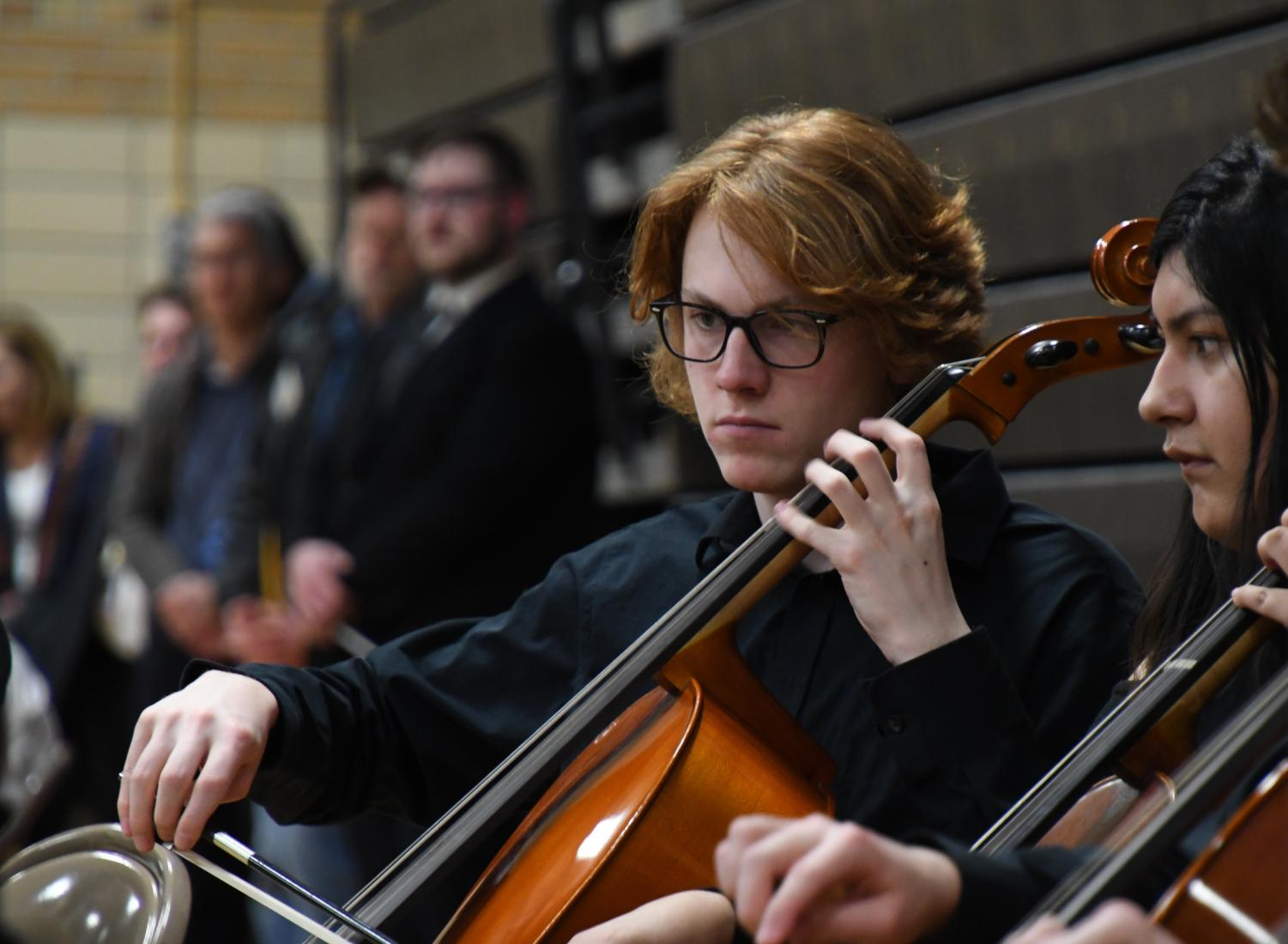 Junior Max Holden plays the Cello during the district orchestra performance in the  Old Gym April. 5. The High School orchestra performed last after the 4th, 5th, 6th, 7th, 8th, and chamber orchestra.