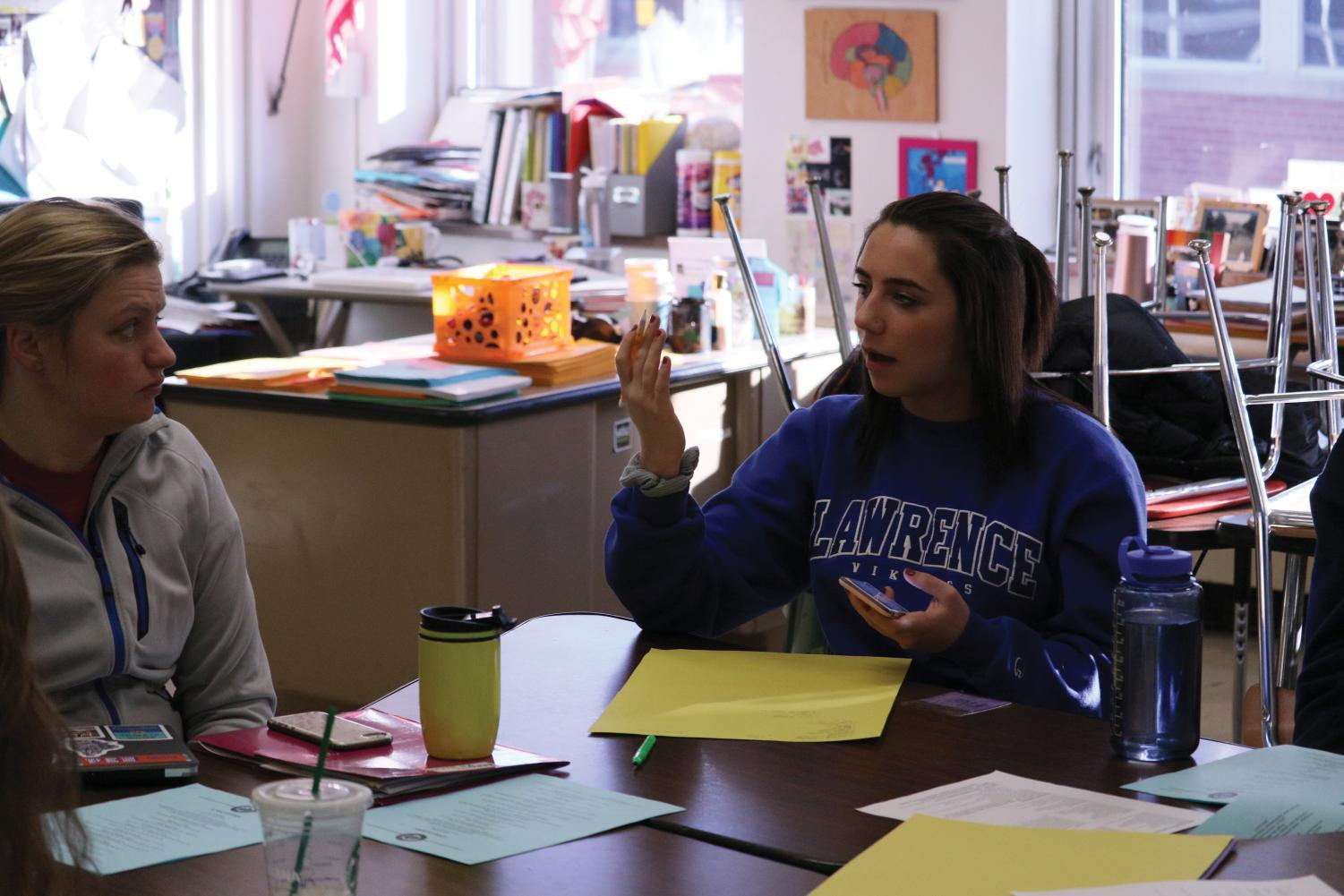 Sophomore Anna Wert talks about her Prom theme ideas with Sarah Lindenberg as well as the rest of the Prom committee. Prom will take place May 5.