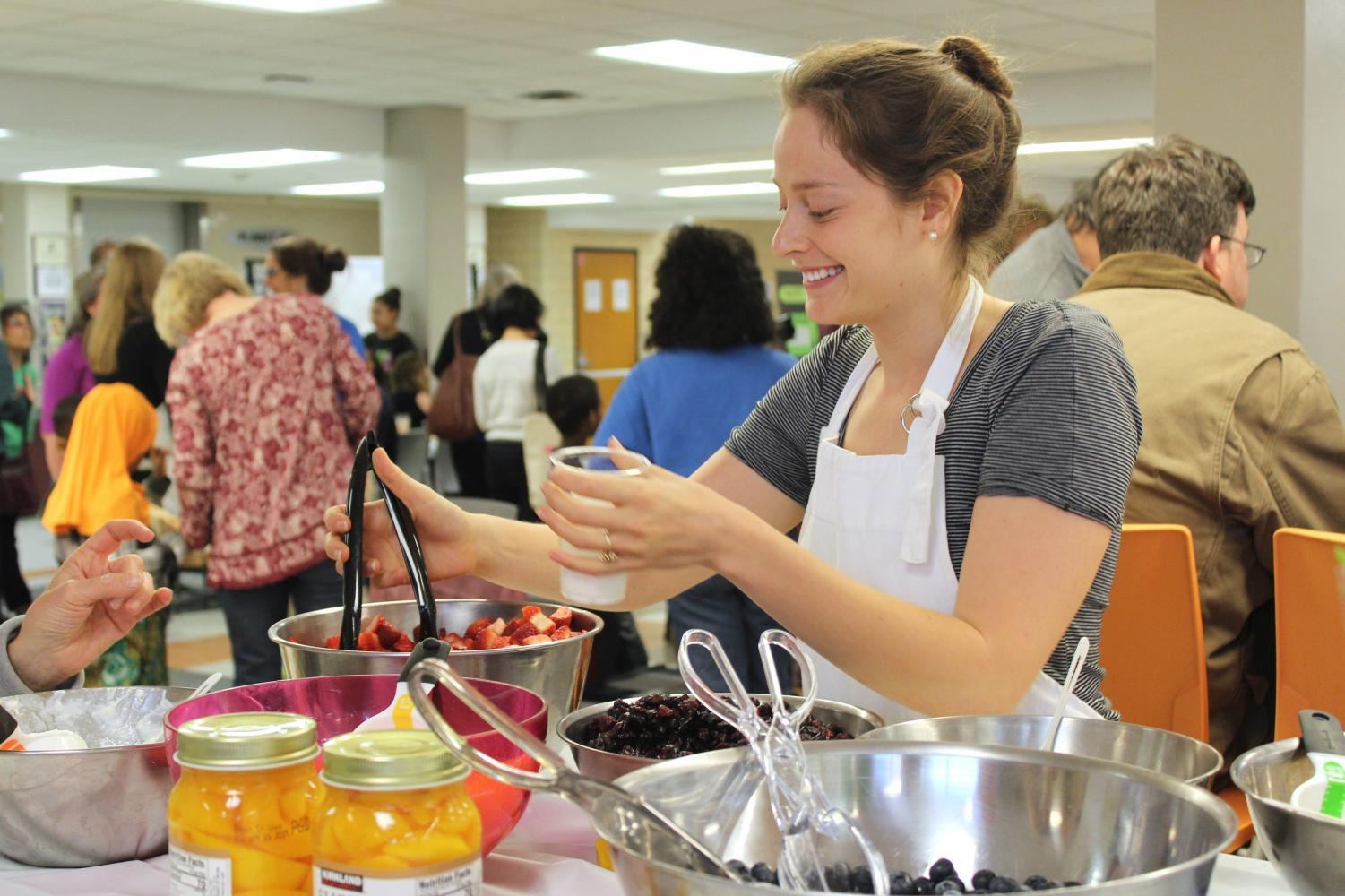 Founder of SEEDS Julie Rapperport serves fruit to students and community members April 24 in the St. Louis Park High School cafeteria.
