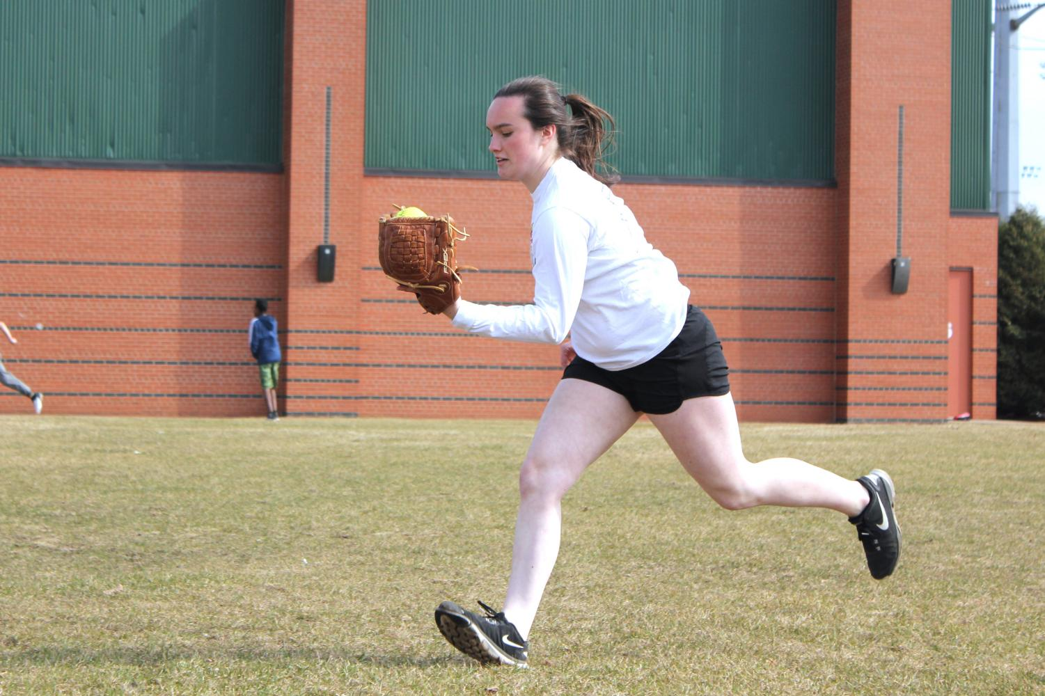 Senior Annabelle Schutte catches a ball during a drill in softball practice April 24. Varsity softball team will be playing Cooper at 4:30 p.m. April 26 at Aquila Fields.