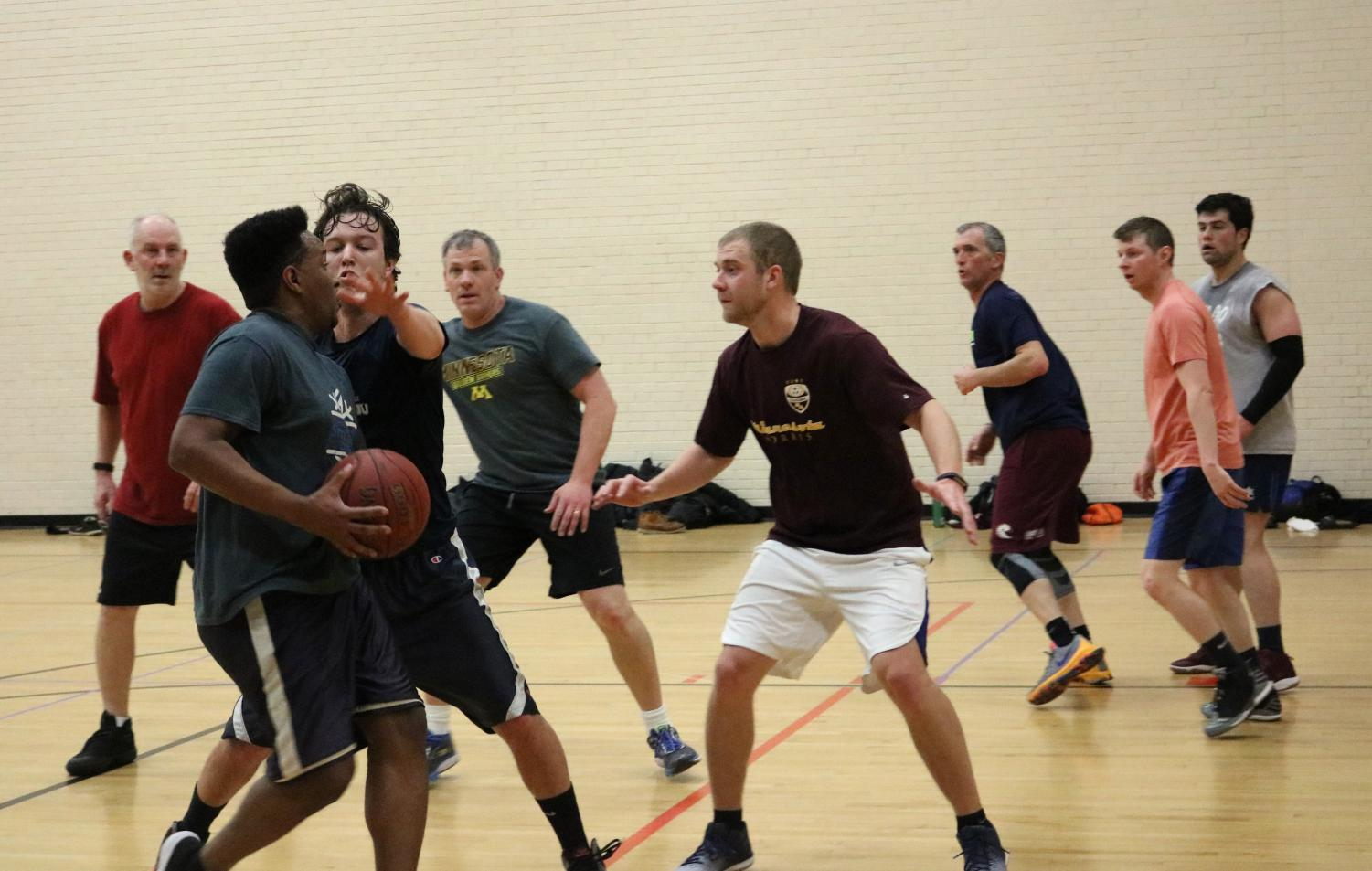 St. Louis Park school district teachers playing a full game of basketball April 11. The teachers get together every week at 6 a.m. on Wednesdays to play at the middle school.