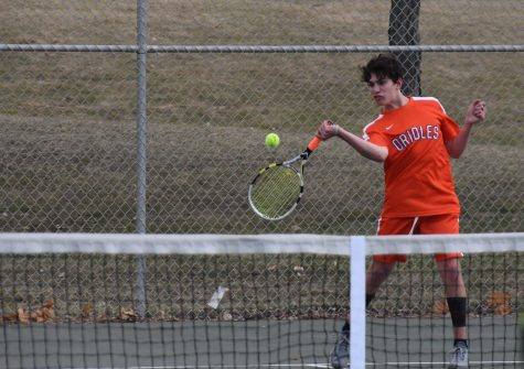 Senior Isaac Swartz swings a forehand returning a shot against Bloomington Jefferson during their match April 24. 2018.