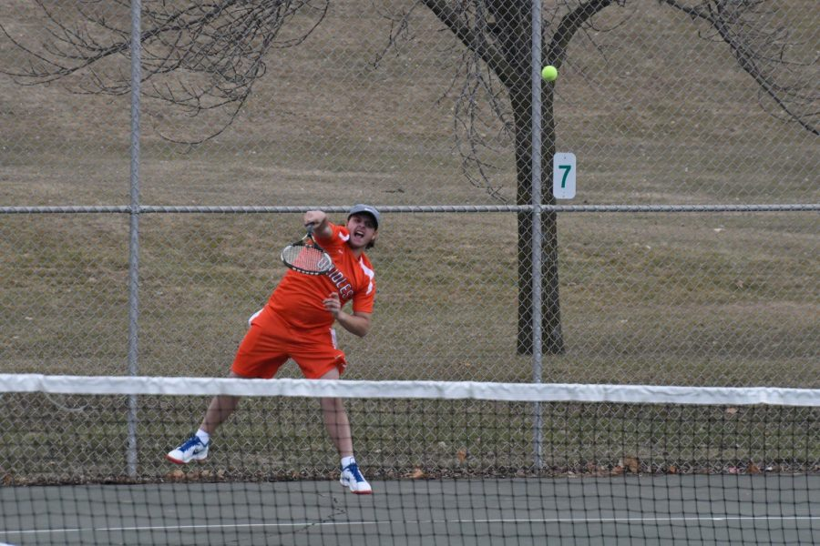 Junior Gerald Perelman smashes a return against Bloomington Jefferson in his match April 24. Park lost 1-6.