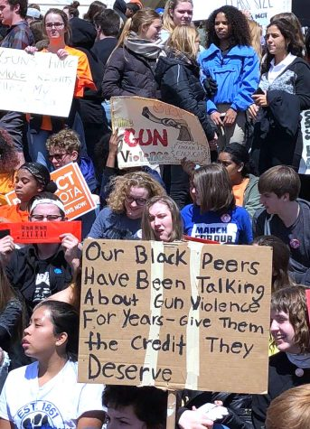 Students from various schools hold posters advocating for gun control. Students walked out of school to protest the cause April 20.