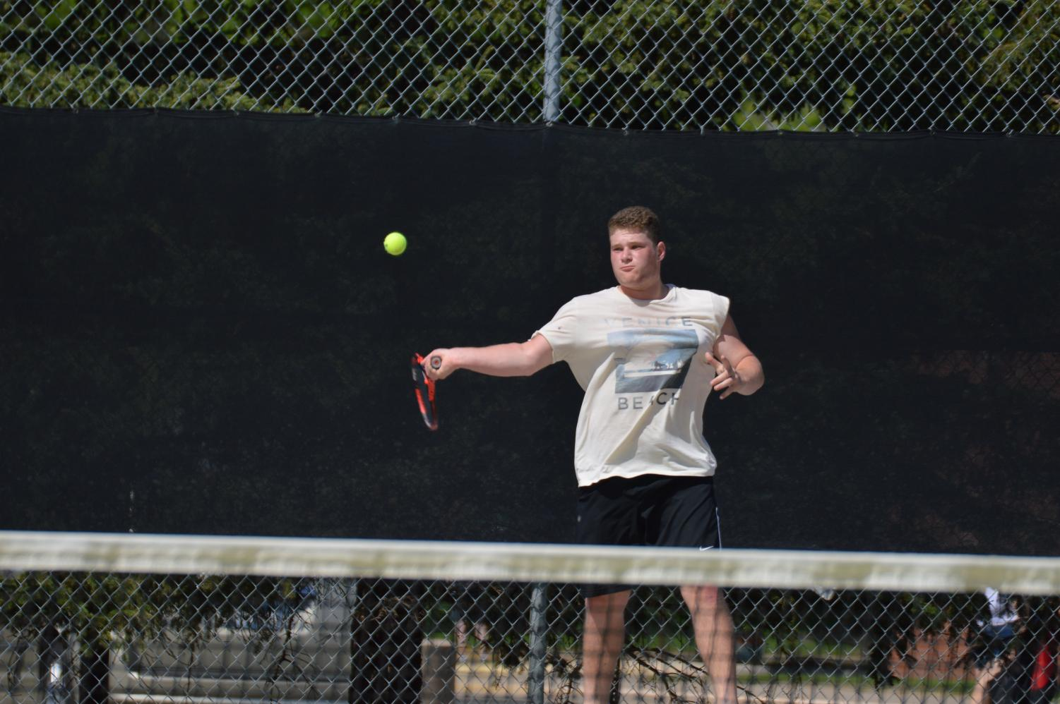 Senior Haim Lyubeznik hits a forehand during practice in preparation for the team's first Sections match May 16 against Apple Valley.