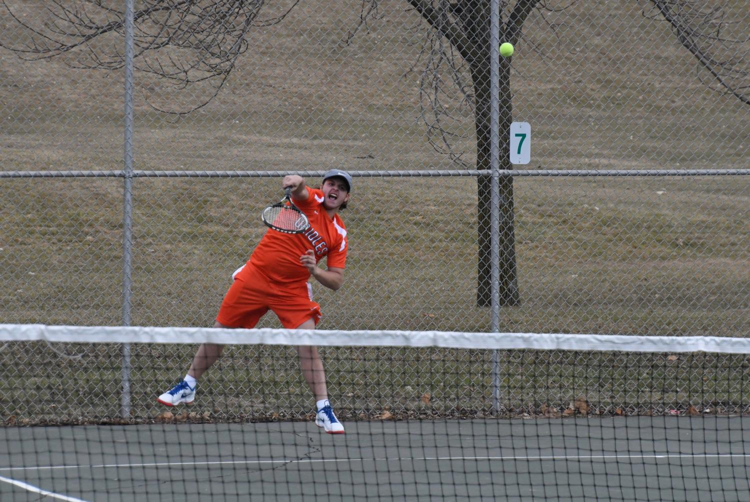 Junior Gerald Perlman hits a serve against Chanhassen Apr. 24. Perlman competed in the individuals tournament May 24 at Baseline Tennis Center.