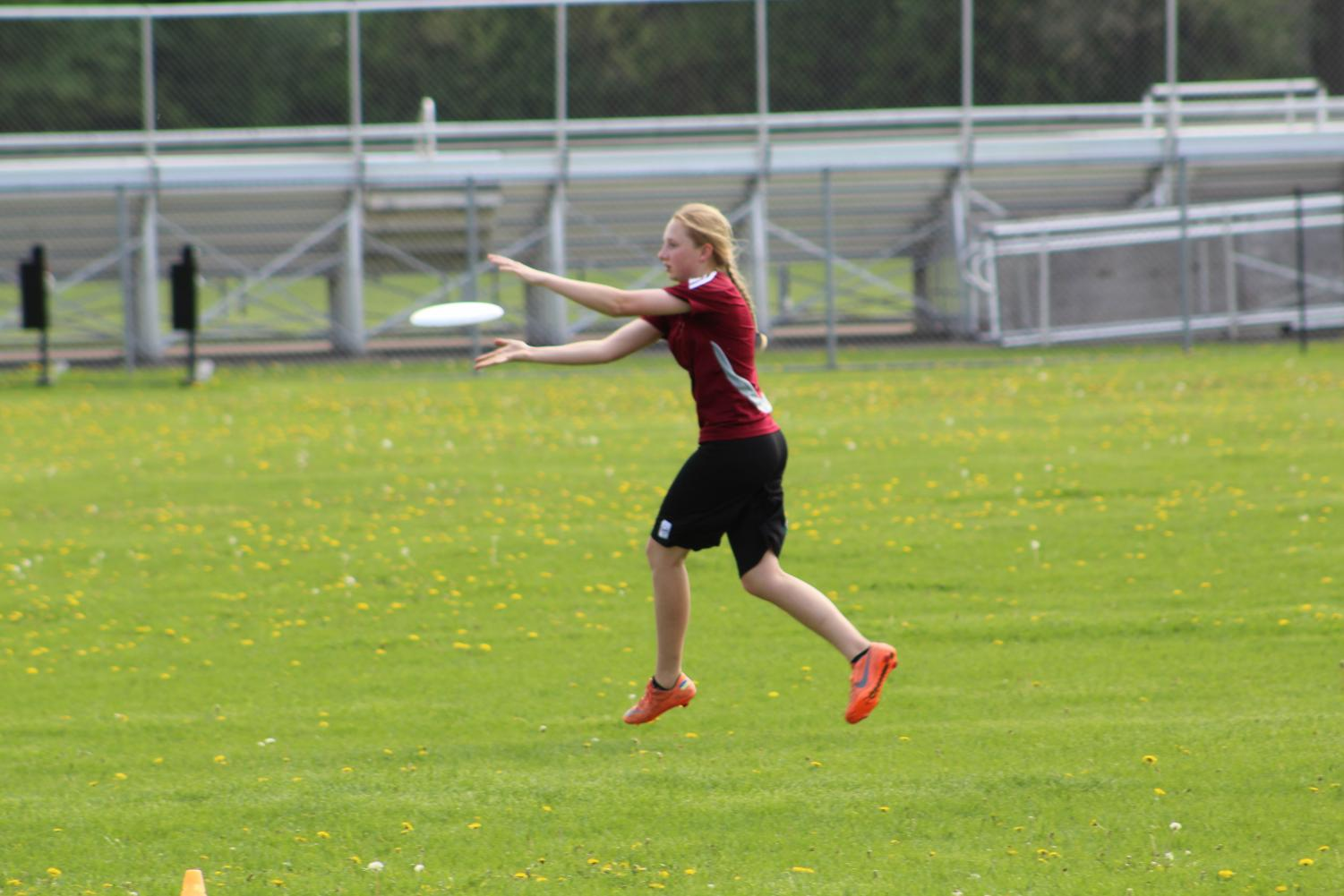 Freshman Amara Foner runs and catches a pass during practice May 21. The team practiced various drills to prepare for their game against Apple Valley May 22.