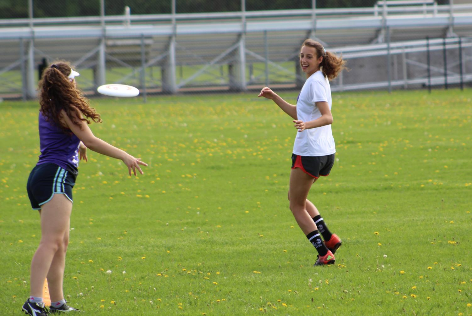 Senior Esther Gendler runs to catch a pass during the girls' ultimate team's practice May 21.