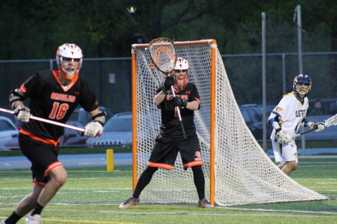 Boys' lacrosse junior goalie steps up