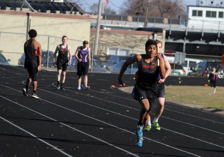 Senior captain Karon Adams runs down the home stretch of his relay. The boys 4x100 relay is .03 seconds from breaking the school record.
