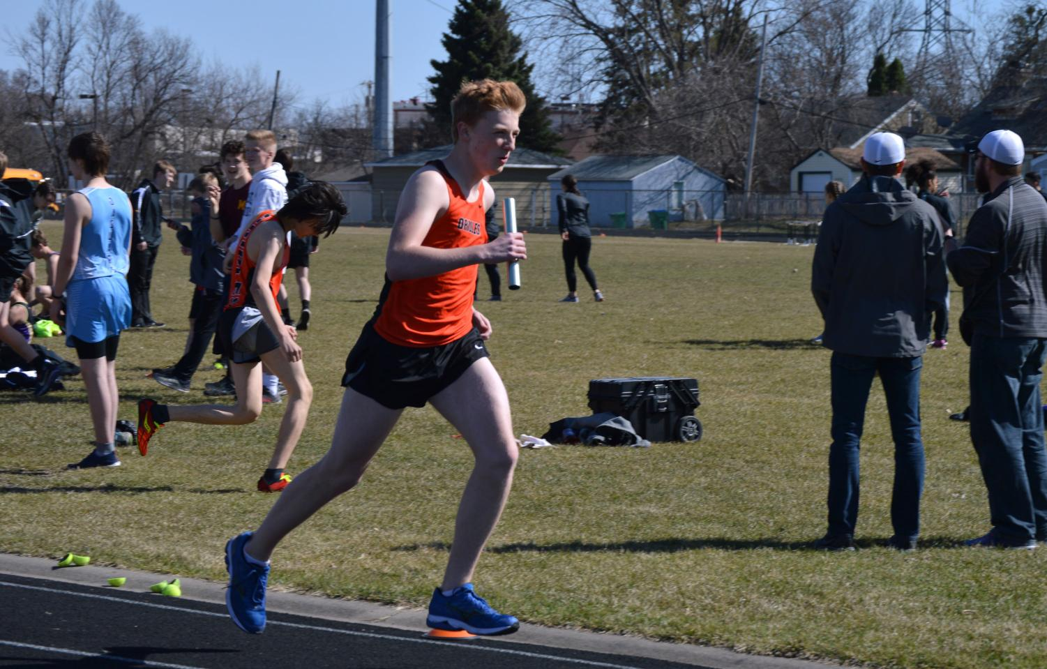 Freshman Maxwell Gohman runs the last leg of the 4X800 at a home track meet April 26. Boys track resumes its Section meet today at 2:30 p.m.