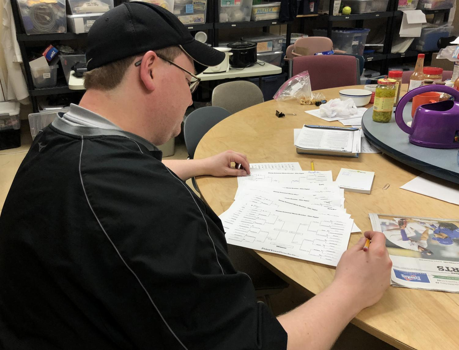 Science teacher Peter Dangerfield tallies up votes on Disney-themed brackets May 2.