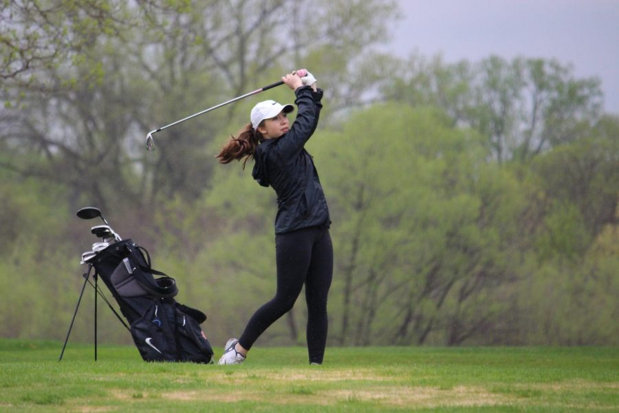 Freshman+Maia+Seidel+hits+an+approach+shot+during+a+match+May+9+at+Brookview+Golf+Course.+The+next+varsity+match+is+7%3A30+a.m.+May+14+at+Rush+Creek.