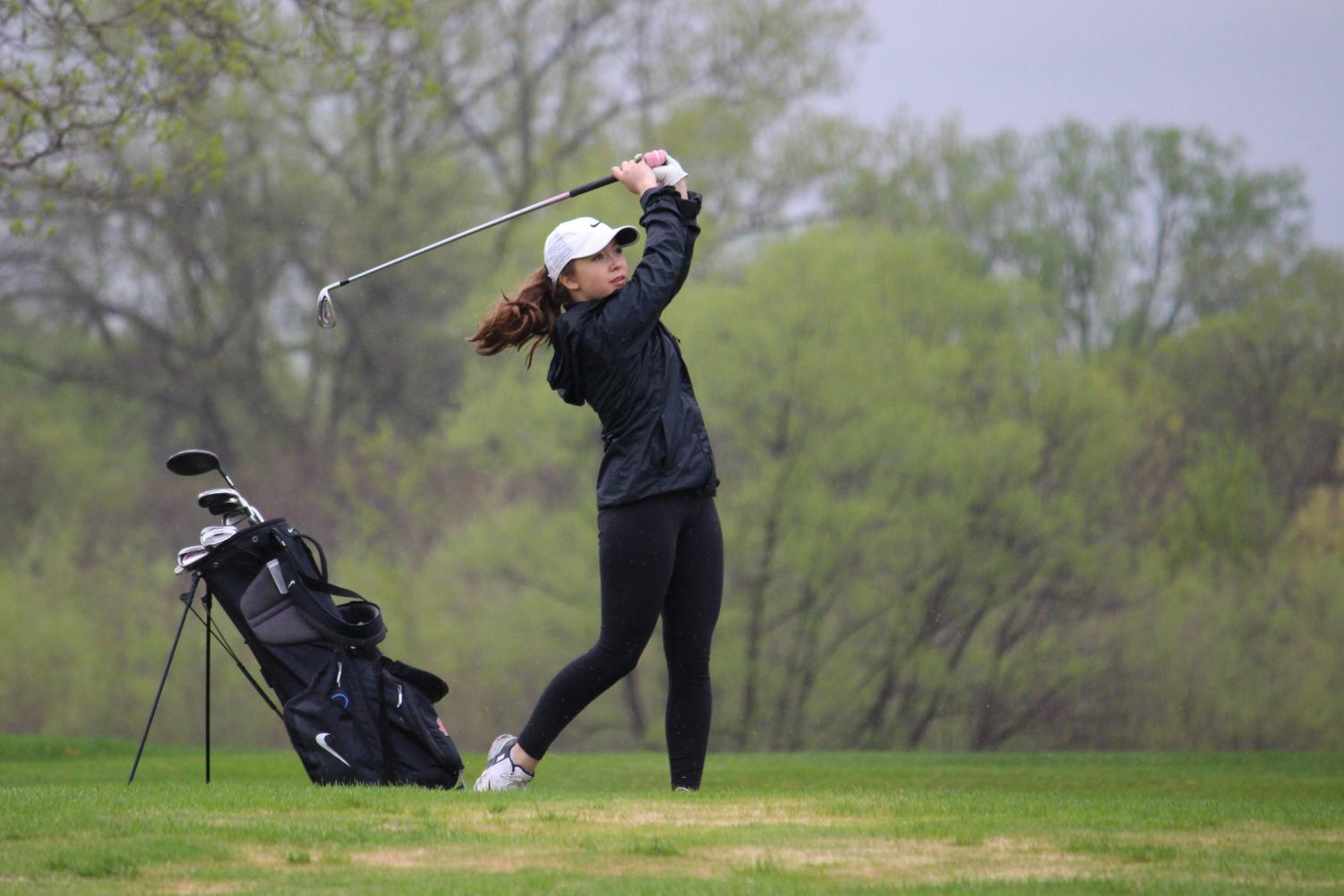 Freshman Maia Seidel hits an approach shot during a match May 9 at Brookview Golf Course. The next varsity match is 7:30 a.m. May 14 at Rush Creek.