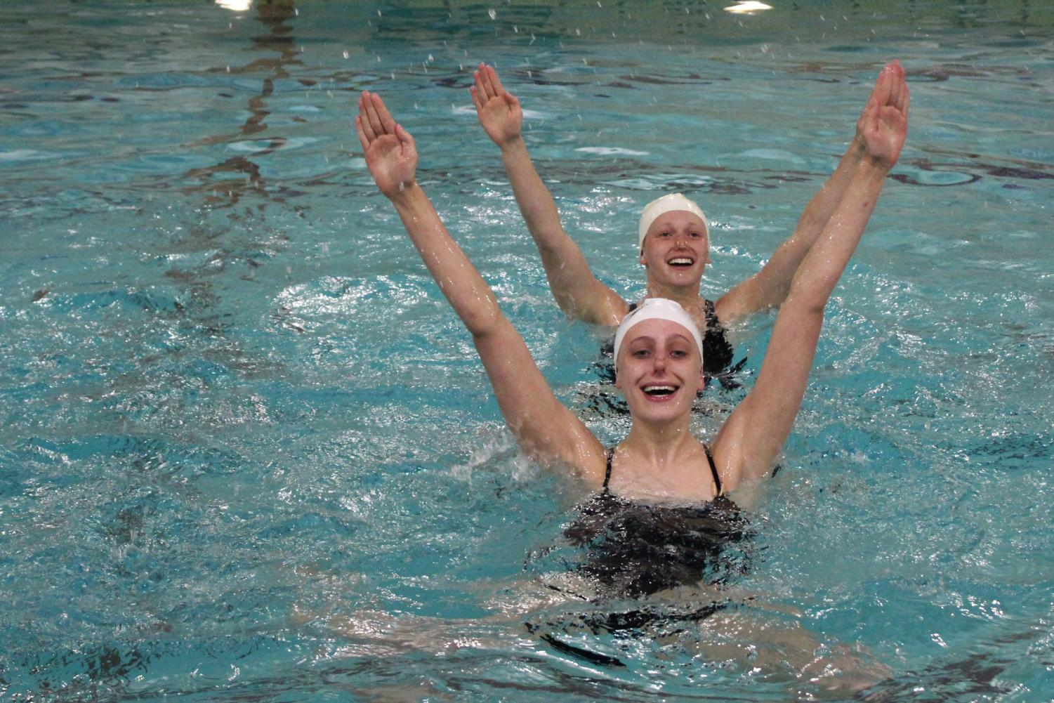 Sophomore Annie Breyak and senior Savannah Kjaer swim their extended duet at the dual meet against Richfield May 3. The team's next meet is at 4:30 p.m. May 8 at the high school swimming pool.