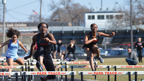 Sophomore Hilda Habia and Jamillah Berry hurdles during the April 26 track meet. The Section track meet was held May 29 and 31 at Orono High School.