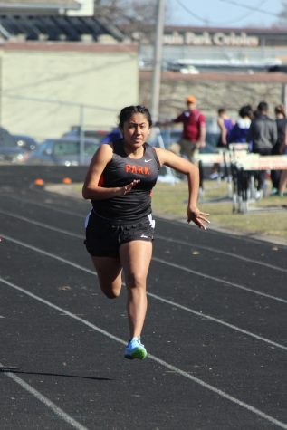 Sophomore Stephanie Perez ran the 200 meter sprint event at SLP on April 26th.