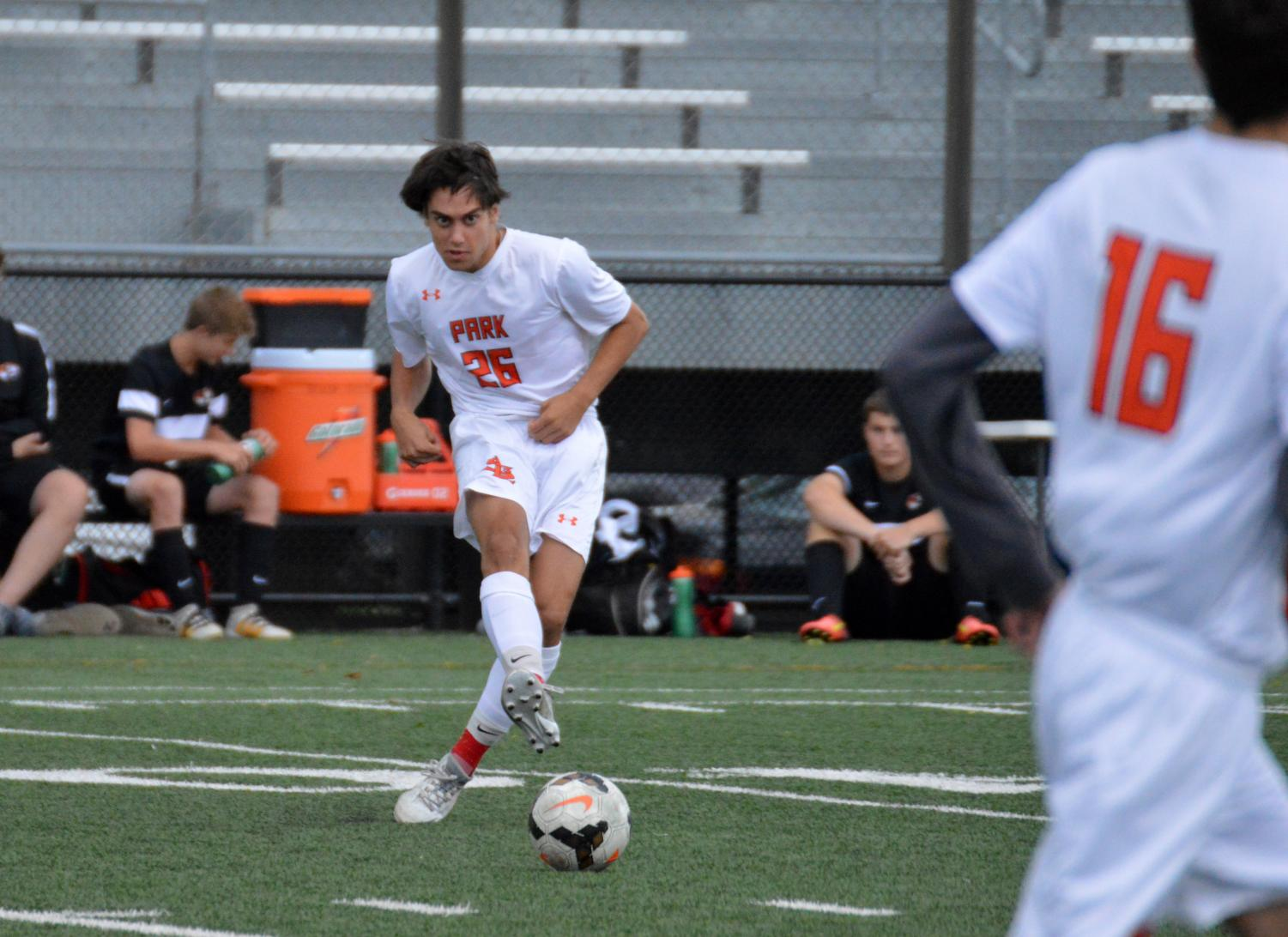 Sophomore Thomas Salamzadeh passes the ball during a boys' varsity soccer game Sept. 5. Salamzadeh will be one of four team captains for the fall 2018 season.