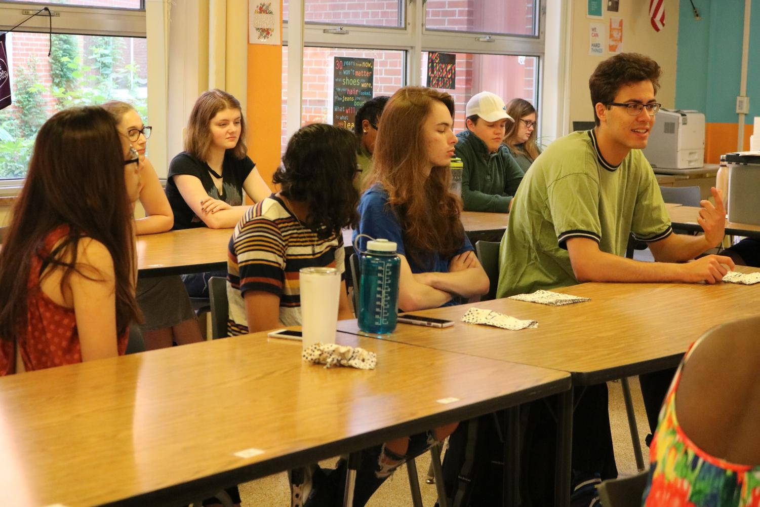 Seniors gather at one table at the last meeting of the year to reflect on Natural Helpers.