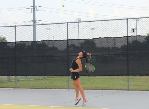 Senior Susanna Hu tracks the ball to serve it to her opponent during their first match of the season Aug. 21 losing 0-7 to Breck. The team ended the season with a 10-5 overall record.