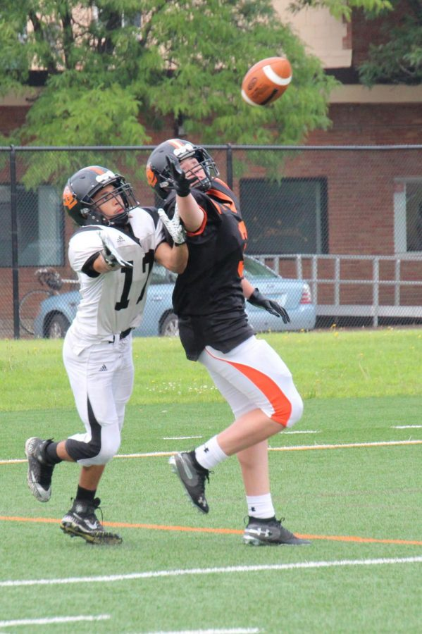 Juniors Jacob Brown and Cole Ewald practice drills during football practice Aug. 24. The team's next game is  at 7 p.m. Sept. 7 against Robbinsdale Cooper at the high school stadium.