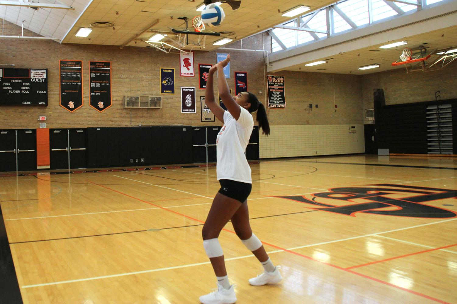 Senior Gabby McCaa works on her setting technique during practice on August 23.  Having good setting skills is essential for a successful volleyball career.