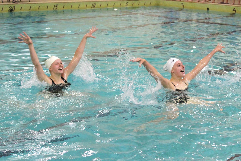 Junior Annie Breyak and last year senior Savannah Kjaer practice a routine to prepare for last year's state meet.