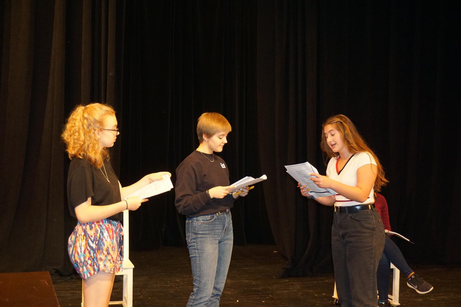 Senior Emma Yarger, Junior Ruby Stillman and Sophomore Phoebe MicKinney rehearse their lines in preparation for their upcoming musical '9 to 5'.