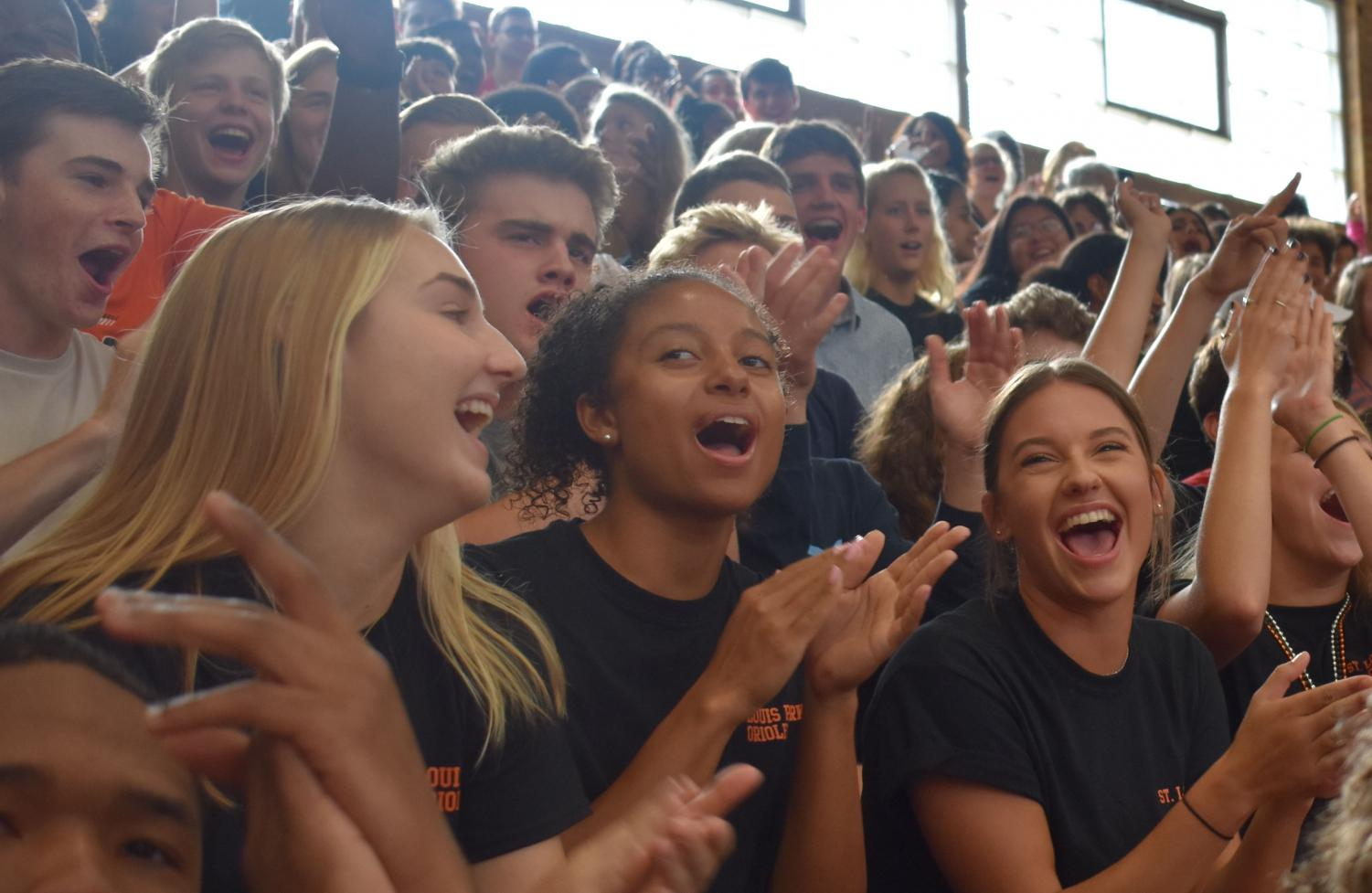 Seniors Daisy Widboom, Madison McIntosh and Violet Huber cheer at the pep fest Sept. 14. Homecoming week has activities and dress codes every day leading up to the dance 7 p.m. Sept 22.
