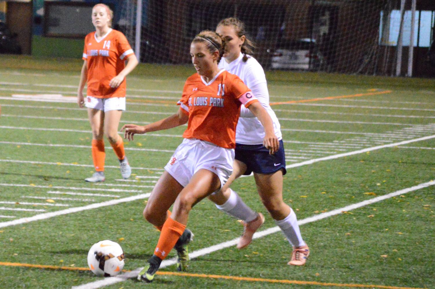 Girls%27+soccer+captain%2C+junior+Ava+Bishop%2C+dribbles+the+ball+along+the+side+lines+toward+the+opponent%27s+goal.+Bishop+played+left+wing+for+the+majority+of+the+game+Sept.+17.