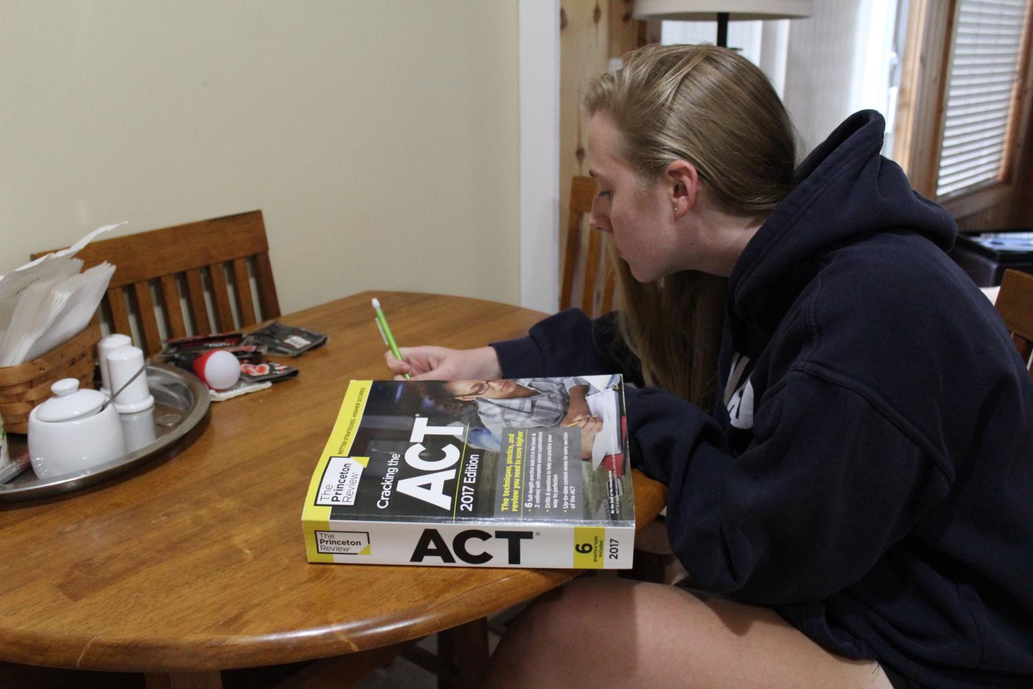 Senior Natalie Aune studies for the writing portion of the ACT. Many colleges recently dropped their ACT/SAT writing section requirement and now accept graded high school essays in its place.