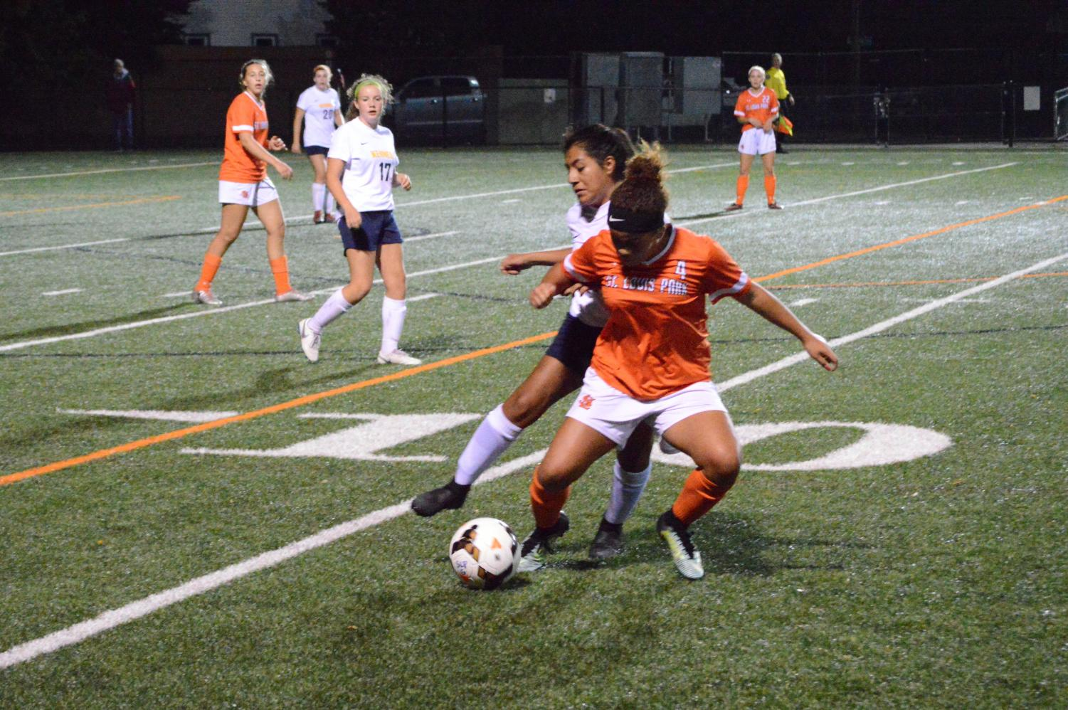 Junior+Aliviah+McClinton+fights+for+ball+possession+towards+the+end+of+the+second+half+of+the+game+Sept.+17.+McClinton+scored+one+of+two+goals+during+Park%27s+game+against+Bloomington+Kennedy.