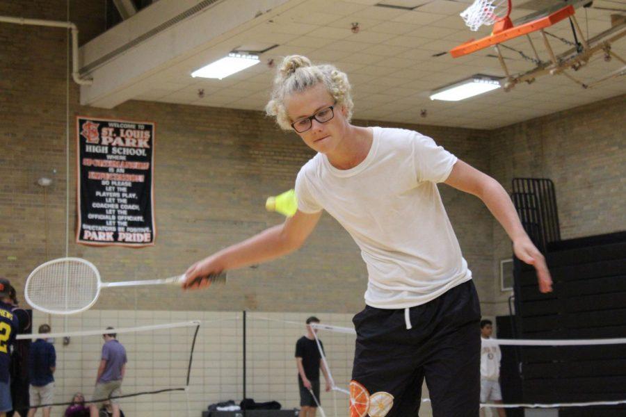 Senior Sam Jensen focuses on hitting the birdie at Badminton on Thursday of Homecoming week.